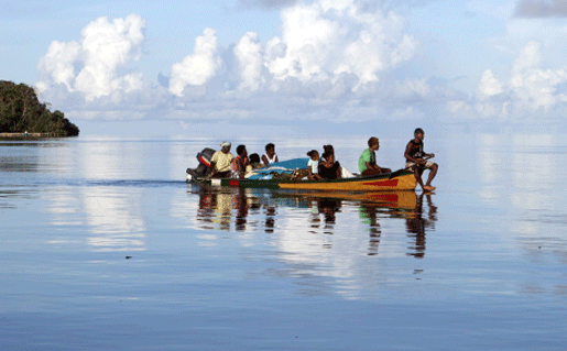 Solomon Islands locals on a boat